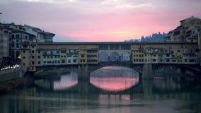 Florence, Italy. The Ponte Vecchio bridge during sunrise. Panning shot stock video footage