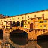 Florence, Italy - Ponte Vecchio over Arno River at sunset. Flore Royalty Free Stock Photo