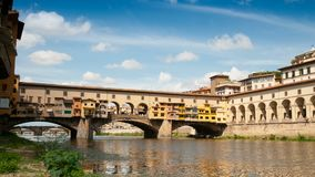 Florence in Italy. Ponte Vecchio on a sunny day. The famous medieval bridge over the Arno river, in Florence, It. Aly. Timelapse 4K UHD Video. Nikon D300 stock video
