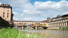 Florence in Italy. Ponte Vecchio on a sunny day. The famous medieval bridge over the Arno river, in Florence, It. Aly. Timelapse 4K UHD Video. Nikon D300 stock footage
