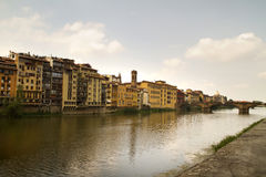 Florence Italy River View. Arno river in Florence Italy with houses and a bridge on teh far end. All signs and IDs cloned out Stock Photos