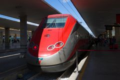Frecciarossa ETR.500 high-speed train on the Florence Central Station. FLORENCE, ITALY-SEPTEMBER 25, 2017: Frecciarossa ETR.500 high-speed train on the Florence Royalty Free Stock Image