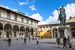 FLORENCE, ITALY - SEPTEMBER 17, 2017: Piazza della Santissima An. Nunziata; a busy paved square nearby famous Florentine museums and art galleries in San Marco royalty free stock photos