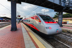 Florence, ITALY- September 10, 2016: Speed train `TrenItalia` of  Frecciargento type in  motion on the station in Florence `Firenz Royalty Free Stock Photos