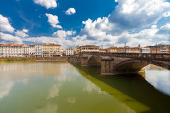Florence, ITALY- September 11, 2016: View on the five-arched bridge Ponte alla Carraia over Arno river in Florence Royalty Free Stock Photos