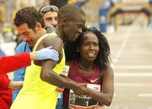 Florence Kiplagat com Abel Kirui em seguida para quebrar o meio recorde mundial da maratona Fotos de Stock