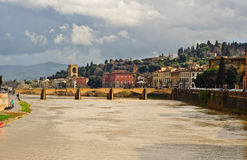 Florence landscape with medieval bridge on Arno river Stock Photos