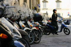Florence Mopeds II. A woman pulls her moped out of a parking space in Florence, Italy Royalty Free Stock Photography