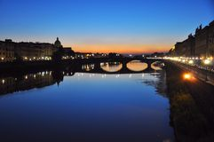 Florence by night, Italy. Urban night secene in Florence city , Italy . Ancient bridges over the main river called Arno Royalty Free Stock Images