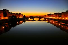 Florence city lights by night, Italy. Urban night secene in Florence city , Italy . Ancient bridges over the main river called Arno. night life out Royalty Free Stock Image