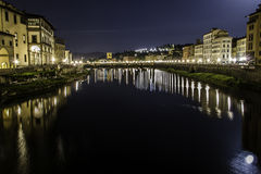 Florence night view. Reflex on water Royalty Free Stock Photography