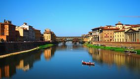 Time lapse of Ponte Vecchio, Florence. Florence, October 2017: Time lapse of old bridge and river Arno on a sunny and cloudless day,on October 2017 in Florence stock video footage