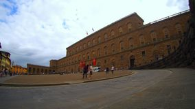 Time lapse of Palazzo Pitti, Florence. Florence, October 2017: Time lapse of tourists waiting before entering Palazzo Pitti, on a warm and cloudy day on October stock video footage