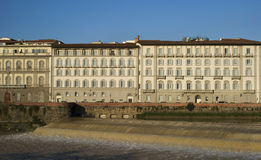 Florence. Old town buildings on the riverbank Arno Stock Images