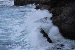 Florence Oregon Rough ocean waves hitting the rocks Royalty Free Stock Image