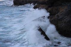 Florence Oregon Rough ocean waves hitting the rocks Royalty Free Stock Image