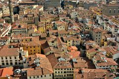 Florence panoramic scene from the Duomo  , Italy. Florence city view with toproofs of historical buildings. old architecture in europe. geometry of the city with Stock Photography