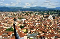Florence panoramic scene from the Duomo  , Italy. Florence city view with toproofs of historical buildings. old architecture in europe. geometry of the city with Royalty Free Stock Photo