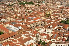 Florence panoramic scene from rooftops , Italy. Florence city view with toproofs of historical buildings. old architecture in europe. geometry of the city with Stock Photos
