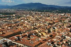 Florence panoramic view from the Duomo  , Italy. Florence city view with toproofs of historical buildings. old architecture in europe. geometry of the city with Royalty Free Stock Photos