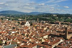 Florence panoramic view from the Duomo  , Italy. Florence city view with toproofs of historical buildings. old architecture in europe. geometry of the city with Stock Photography