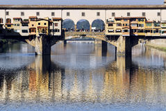 Florence - Ponte Vecchio. Glistening in the Arno river, Ponte Vecchio's colourful profile Royalty Free Stock Photos