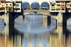 Florence - Ponte Vecchio. Glistening in the Arno river, Ponte Vecchio with its' arches and colour stock images