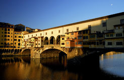 Florence - Ponte Vecchio. Ponte Vecchio in the morning sun, with the moon still up high Royalty Free Stock Image