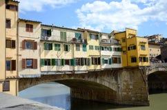 Florence - Ponte Vecchio bridge. Cityscape of Florence, Italy with river Arno reflection. Uffizi Gallery and famous Ponte Vecchio bridge Royalty Free Stock Photo