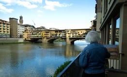 Florence - Ponte Vecchio bridge - gray painter. Cityscape of Florence, Italy with river Arno reflection. Uffizi Gallery and famous Ponte Vecchio bridge Royalty Free Stock Image