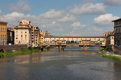 Florence - Ponte Vecchio by a cloudy day. View of famous old bridge from Florence Royalty Free Stock Photos