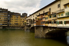 Florence Ponte Vecchio Side. Arno river in Florence Italy with houses Ponte Vecchio seen from the side. All signs and IDs cloned out Royalty Free Stock Photography