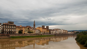 Florence on a rainy day. Reflection of Florence in river Stock Images
