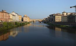 Florence is reflected in the Arno river. stock photos