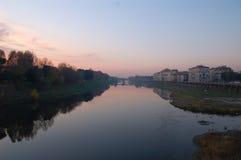 Florence River Bridge et vieilles Chambres dans le coucher du soleil Images libres de droits