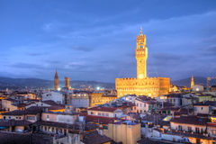 Florence skyline - Palazzo Vecchio, Italy. Twilight scene of Florence (Firenze) skyline seen from above the rooftops with focus on one of the landmarks of the Royalty Free Stock Image