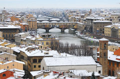 Florence on a snowy day in winter, Tuscany, Italy. Florence on a snowy day in winter, old bridge - Ponte Vecchio Royalty Free Stock Image