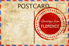 Florence stamp on a vintage, old postcard Stock Image