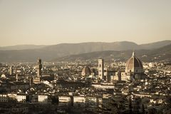 Florence at sunset light. Cattedrale di Santa Maria del Fiore. Tuscany, Italy. Aged photo effect. The view of Florence at sunset light. Cattedrale di Santa Stock Photography