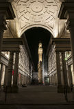 Florence tower in the night. Florence tower of Palazzo Vecchio during the night through the arch of Uffizi museum building... this angle was very interesting to Stock Images