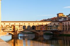 Florence town and the Ponte Vecchio bridge at sunset the Arno ri. Ver in Italy, Europe Royalty Free Stock Photography