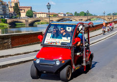 Florence. Travel tour. Florence, Italy - 18 May, 2015: Tourist tour of Florence on ecologically pure electric cars. Electric cars in European cities are very stock image