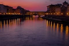 Florence,tuscany/Italy 20 february 2019 : the ponte vechio bridge snapshot taken at golden hour beautiful colors and excellent arc royalty free stock photography