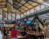 People visiting and eating in the famous central market of Florence called `Mercato centrale` Royalty Free Stock Photos