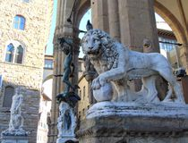Florence Tuscany Italy. Medici Lion and Perseus statues in Loggia dei Lanzi. Florence Tuscany Italy, November 8th, 2018. Medici Lion and Perseus statues in stock image