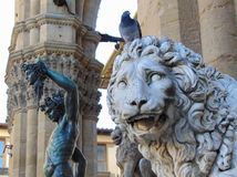 Florence Tuscany Italy. Medici Lion and Perseus statues in Loggia dei Lanzi. Florence Tuscany Italy, November 8th, 2018. Medici Lion and Perseus statues in stock photo