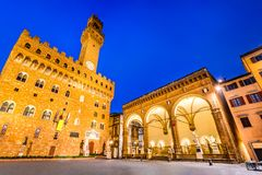Florence, Tuscany, Italy - Palazzo Vecchio. Florence, Italy. Palazzo Vecchio or Palazzo della Signoria  and Loggia dei Lanzi, twilight scene in Tuscany Royalty Free Stock Photography