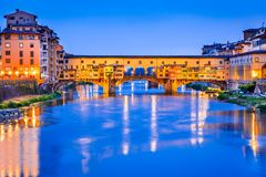 Florence, Tuscany, Italy - Ponte Vecchio and Palazzo Vecchio. Florence, Tuscany - Ponte Vecchio and Palazzo Vecchio at night, Renaissance architecture in Italy Royalty Free Stock Photography