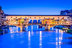 Florence, Tuscany, Italy - Ponte Vecchio and Palazzo Vecchio. Florence, Tuscany - Ponte Vecchio and Palazzo Vecchio at night, Renaissance architecture in Italy Stock Image