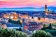 Florence, Tuscany, Italy - Ponte Vecchio and Palazzo Vecchio. Florence, Tuscany - Ponte Vecchio and Palazzo Vecchio at night, Renaissance architecture in Italy Royalty Free Stock Image